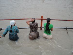 Chuttiyappa: Indian Girls at River Ganga Bathing Outdoor wet Dressed