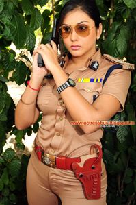 Namitha Photos: Namitha structure visible in Police dress tight dress