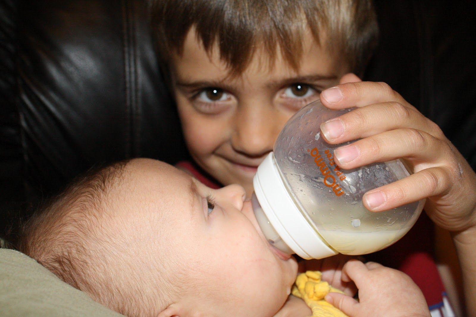 Sister Ing Her Brother With Breast Milk