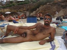 more men naked on the beach