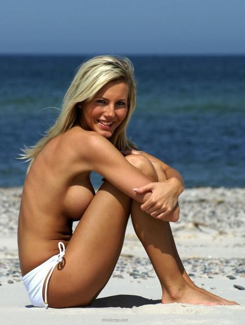 Hot Topless Blonde On The Beach