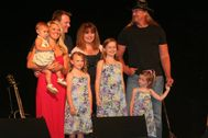 Finally � Trace Adkins lives in ahouse with 6 women and says, �I