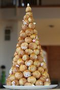 croquembouche is a tower of cream puffs held together with caramel