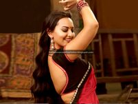 Sonakshi Sinha's shows her nude back and bulging breasts in a braless