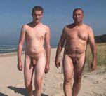 dad son naked beach stroll