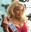 Amber Heard has got some sexy Cleavages @ Machete Kills Posters