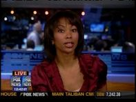 harris faulkner  dark red satin blouse