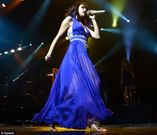 Hello legs! Selena Gomez, 19, looks very grown up as she performs in a