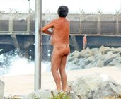 Spy Cam Dude: Dad naked in beach shower