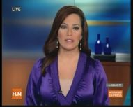 robin meade  purple satin dress