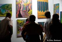 Patrons enjoying local art! (Photo by Celia Sorhaindo)