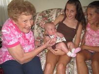 Here's Grandma, Katie, and Carrie playing with sweet Sylvia  It was
