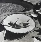 Andre De Dienes  Marilyn Monroe lying naked on a trampoline, 1953