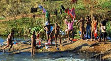 Swazi women bathing in river naked, ahead of the reed dance ceremony