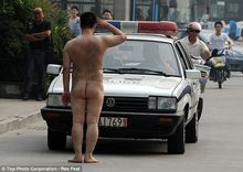 Naked Chinese Man Brings Traffic to a Halt