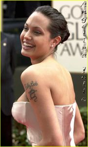 angelina jolie s tattoo laser and cover up angelina jolie tattoos and