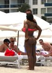 Serena Williams showing off pink bikini cleavage & superb big