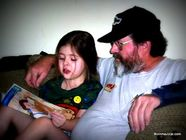 Tyler (then 5 years old) reading to Grandpa