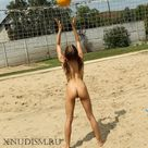 Naked girls nudists youngsters are having sex on a beach volleyball