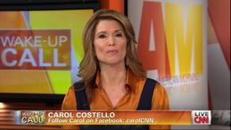 Carol Costello  orange satin blouse under jumper