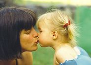 motherdaughterkissbabymouth jpg