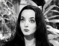 CAROLYN JONES as MORTICIA ADDAMS