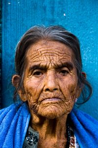 across this old women sitting on the step of her house old nude women