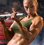 Pretty muscular for a woman, but she still looks feminine to me.