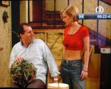 Kelly Bundy with short hair/bob, redred cropped top and 1990s jeans