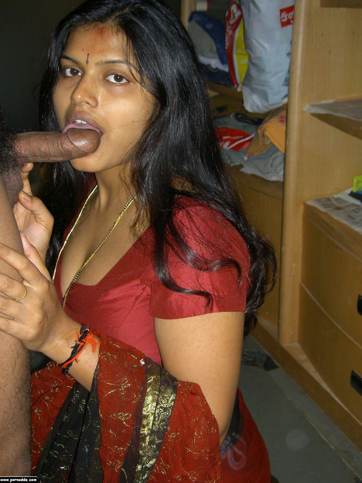 Indian Aunty Sucking On His Cock