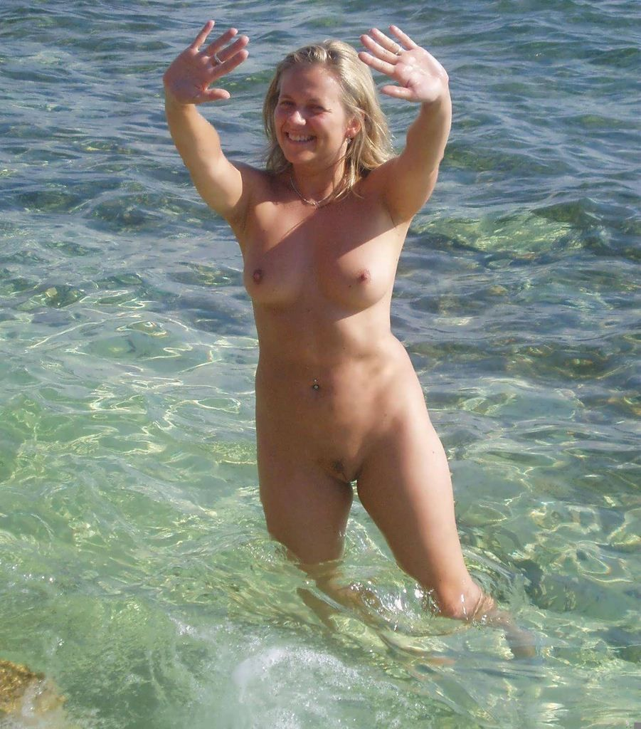 Nudist Girls Oiling Each Other On The Beach