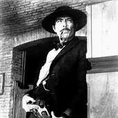 Lee Van Cleef In A Movie Still From