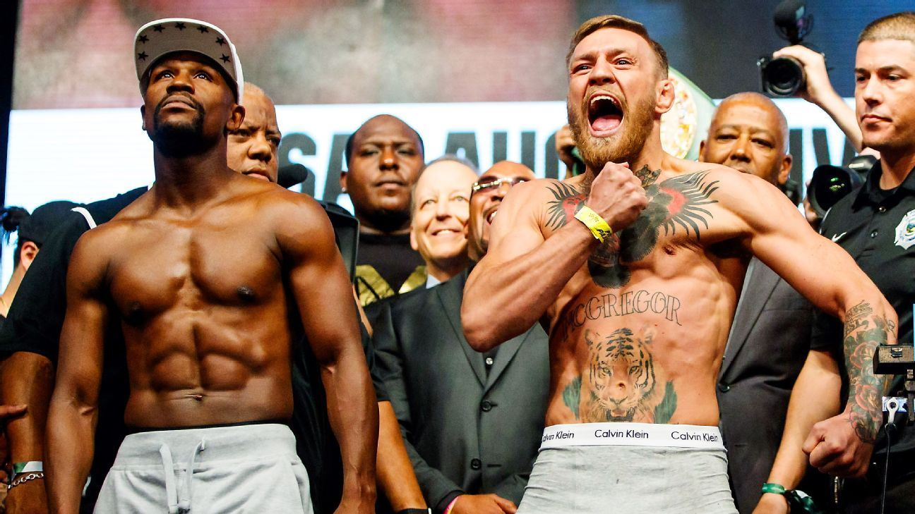 Conor McGregor, Floyd Mayweather both weigh in under 154-pound limit - ESPN