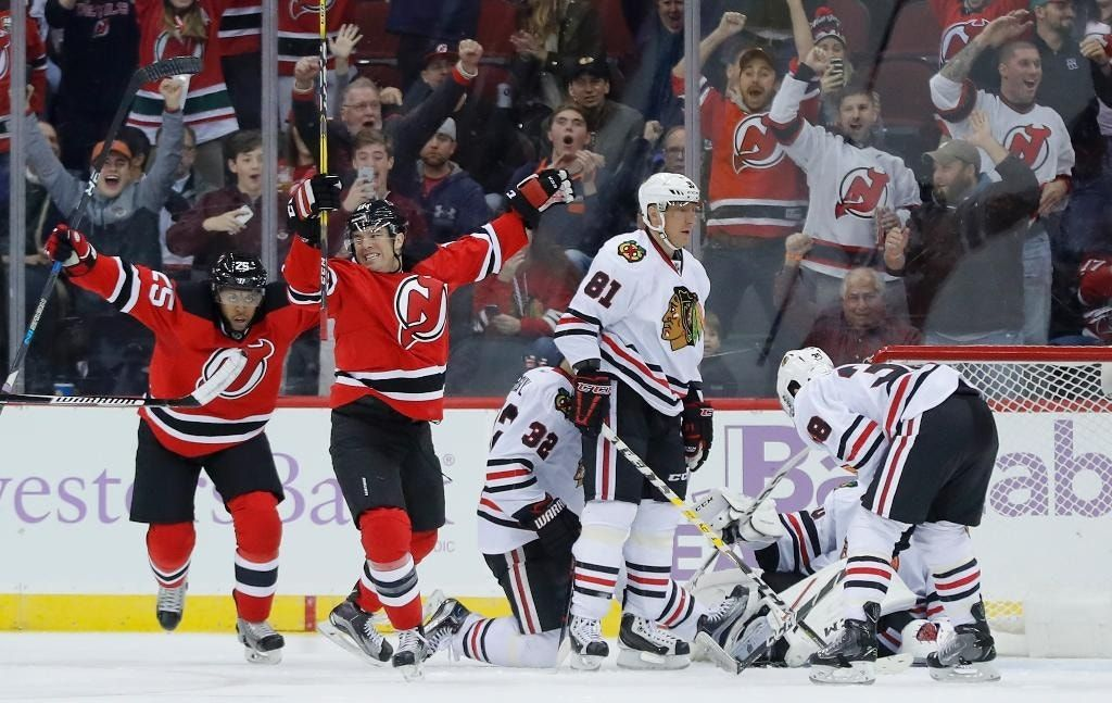 Artem Anisimov lifts Blackhawks past Devils in OT