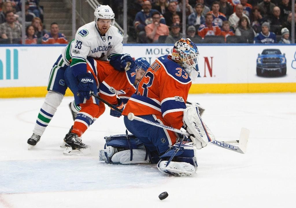 Talbot makes 33 saves, Oilers blank Canucks 2-0