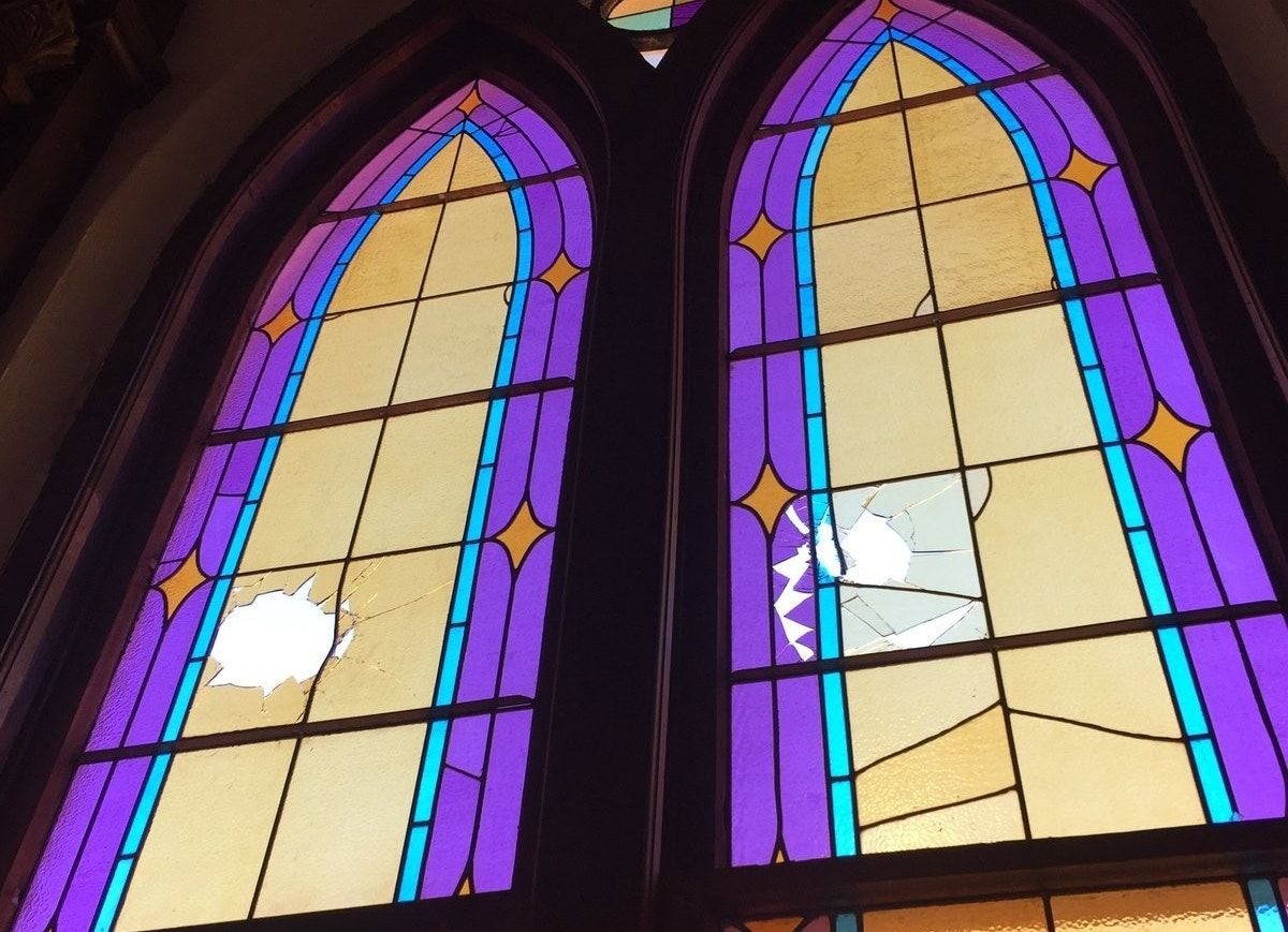 Photos: Vandal smashes windows of Denver's oldest active church