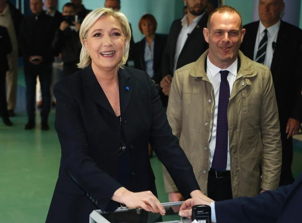 The Latest: Le Pen's party hails conservative's backing