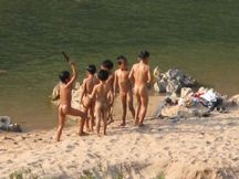 bunch of young boys happily frolicking around nude taking their