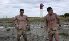 Shirtless soldiers outside