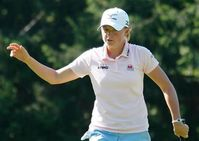 Stacy Lewis of USA reacts as she play on the seventeenth hole during
