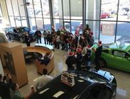 Photo: CHS students carol at Shelor Motor Mile  Roanoke Times: The