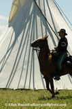 , Montana, 7th Cavalry soldier rides past tipi, MODEL RELEASED