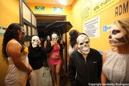 Mexican prostitutes wearing face masks pay homage to their dead