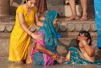 Women bathing in the holy river Ganges at Varanasi, Uttar Pradesh