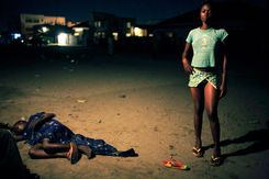 Betty Nginamawu, age 14, a child prostitute, solicits clients while