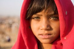 beautiful young girl with red scarf: India: far away places: Scott