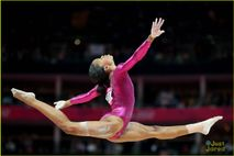 About This Photo Set: Gabrielle Douglas shows off her shiny gold medal