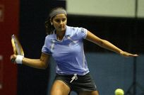 Indias Sania Mirza plays against Germany's Sandra Kloesel, unseen