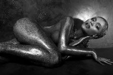 Beyonce is naked and doused from headtotoe in glitter for Flaunt