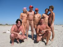 group of naturists on a nude beach